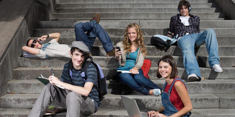 High school students sitting on steps